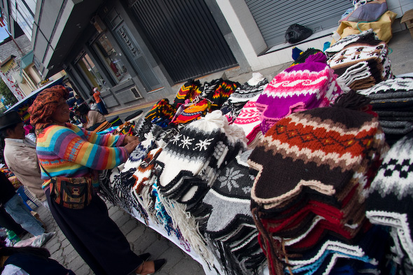 Otavalo market wool hat vendor