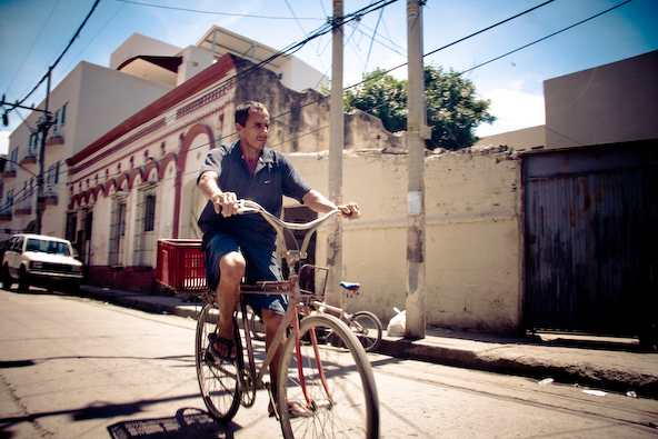 Man riding on bicycle, Colombia