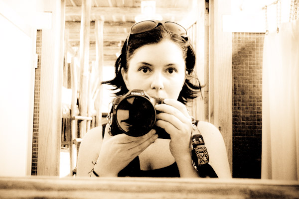 girl self portrait with camera