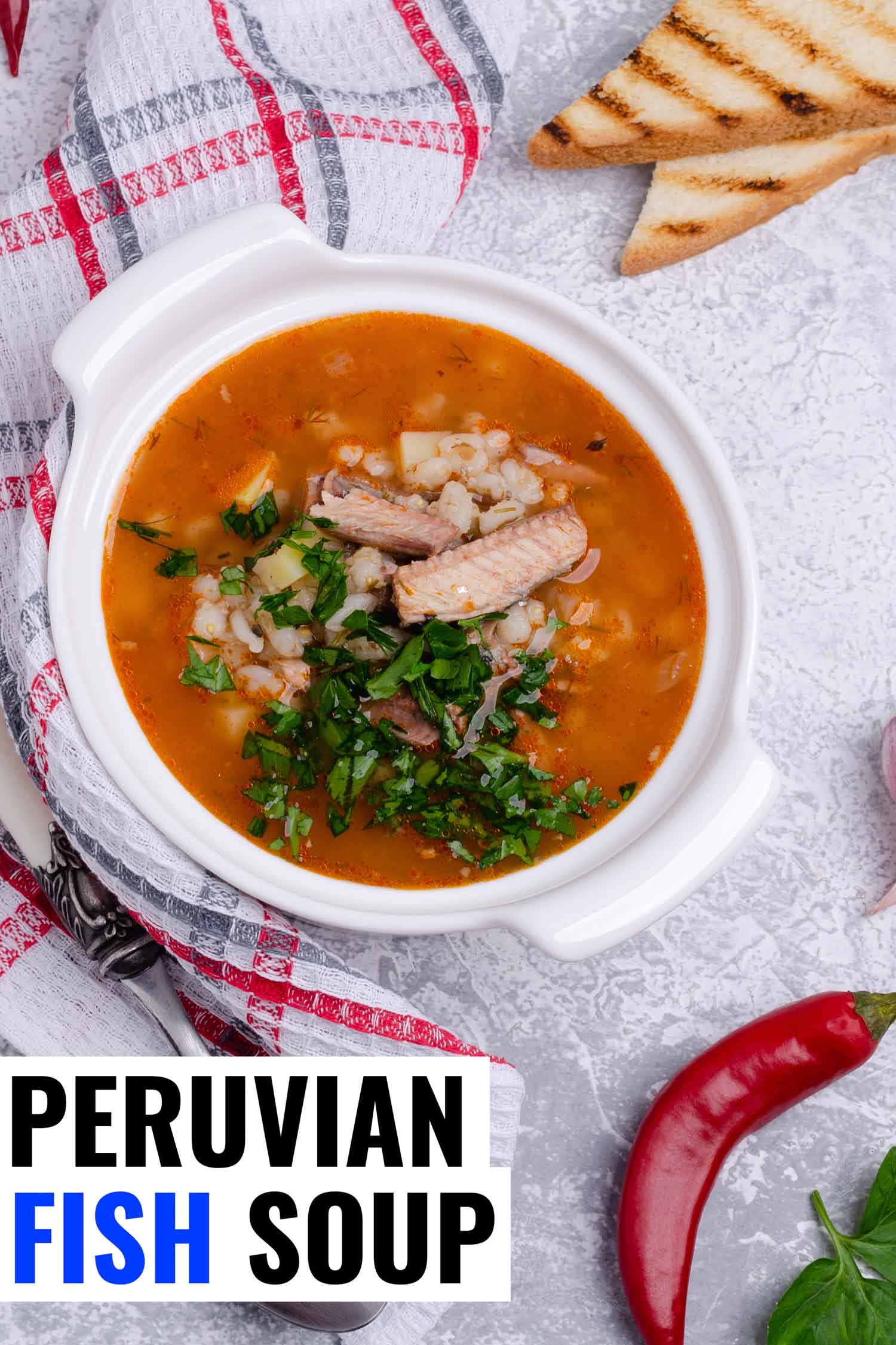 Peruvian fish soup called sudado in a white bowl.