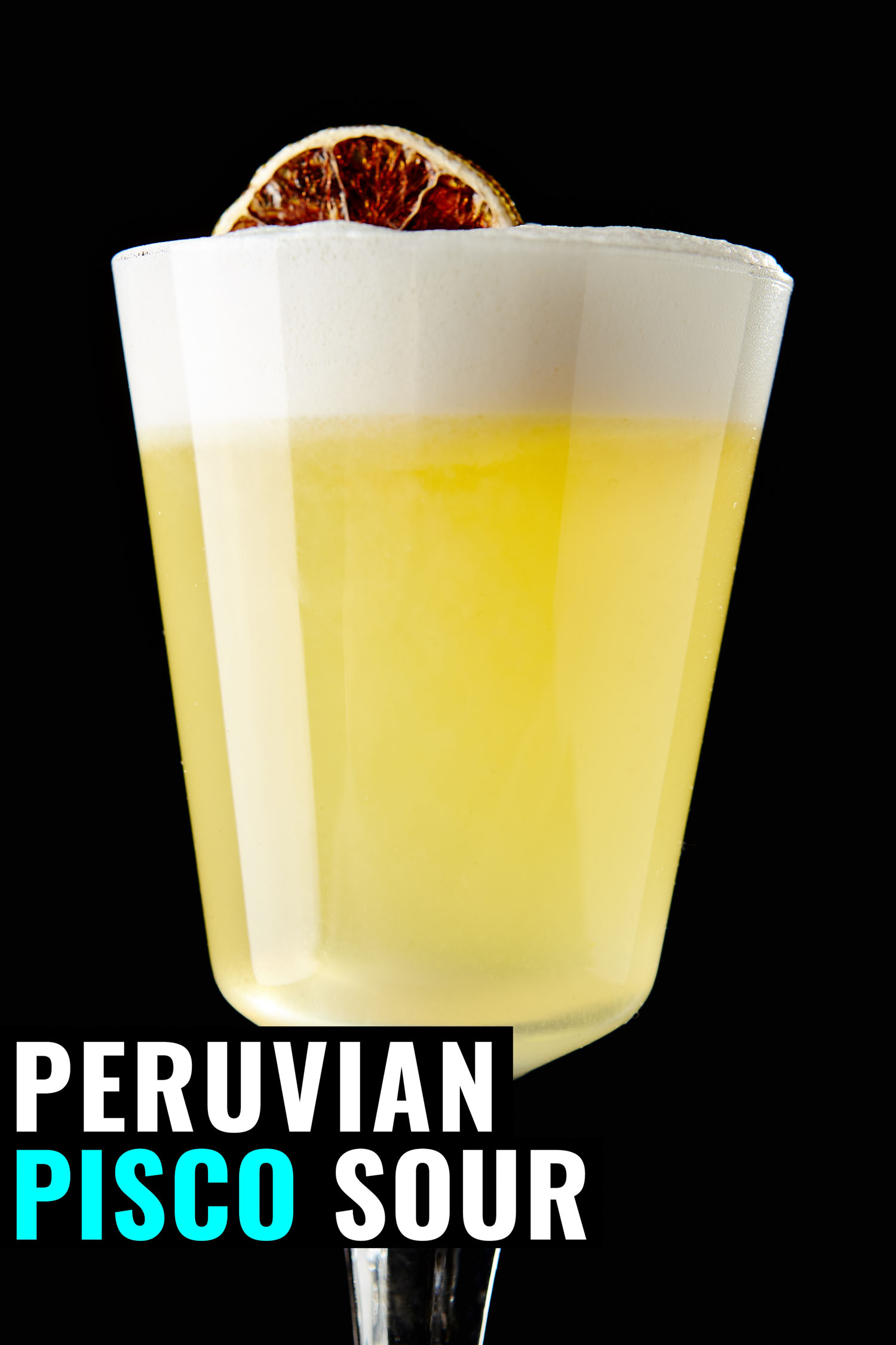 Peruvian pisco sour on a black background garnished with a blood orange.