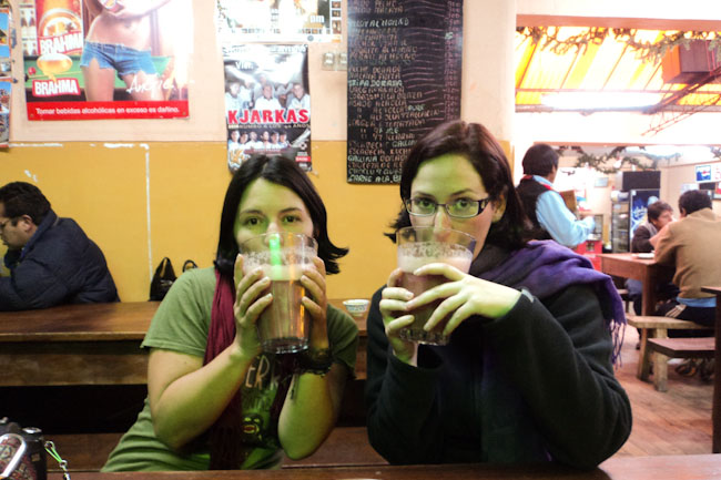 two girls drinking chicha