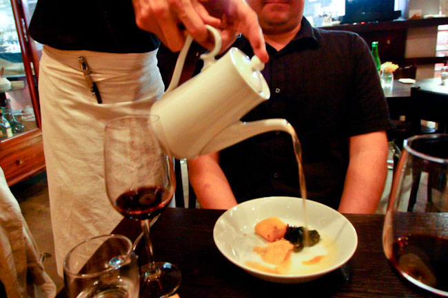 waiter pouring broth