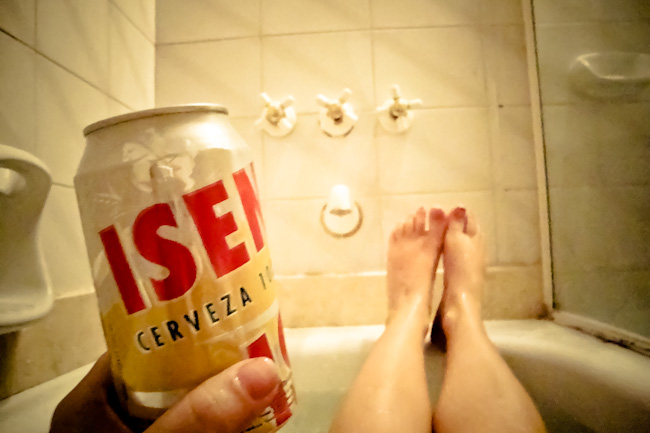 girl in bath with beer