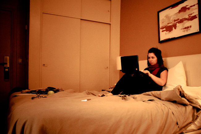 girl in hotel room on laptop