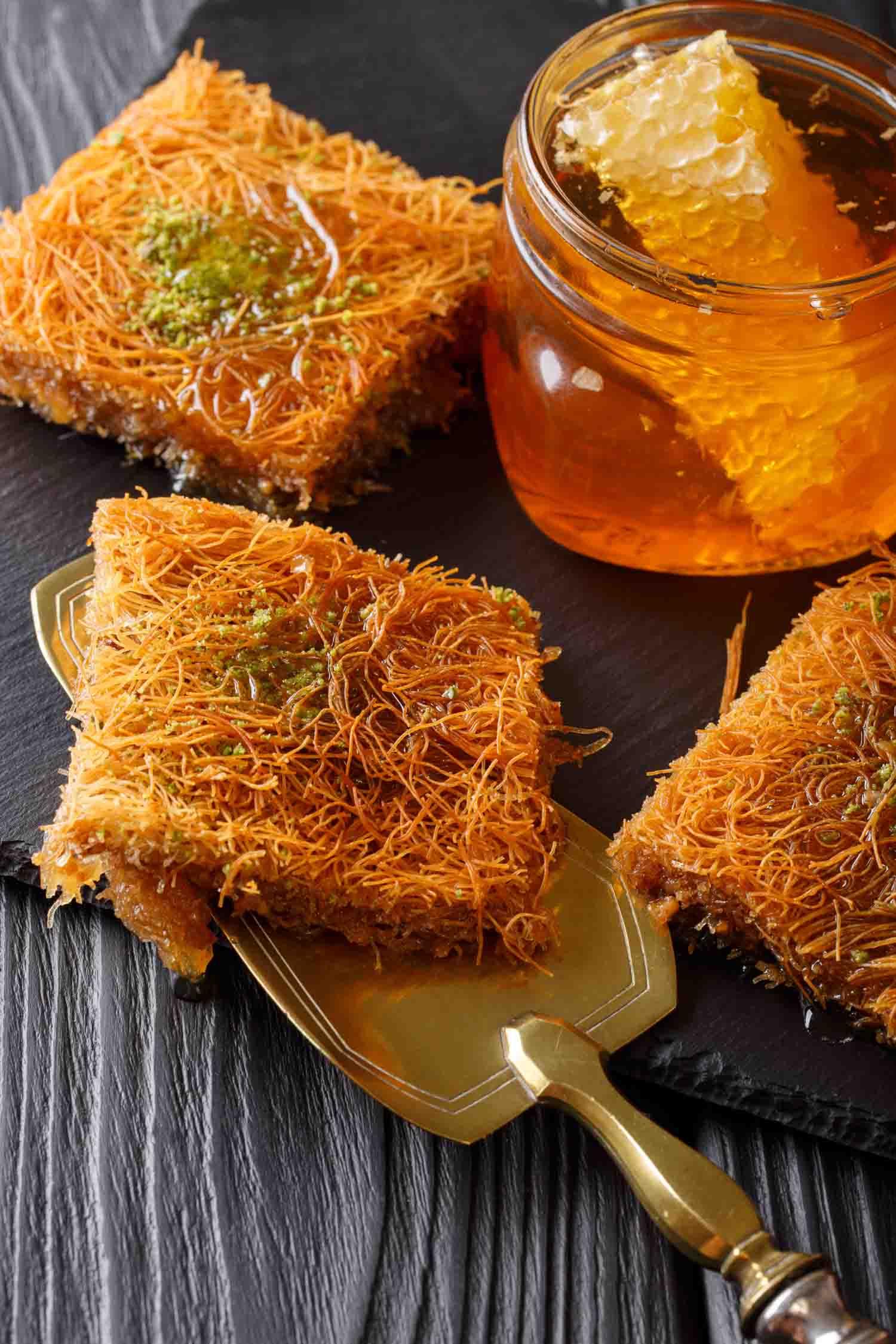 Food in Jordan, Traditional Arabic pastry cake with pistachio named kadaif or kataifi closeup. Vertical