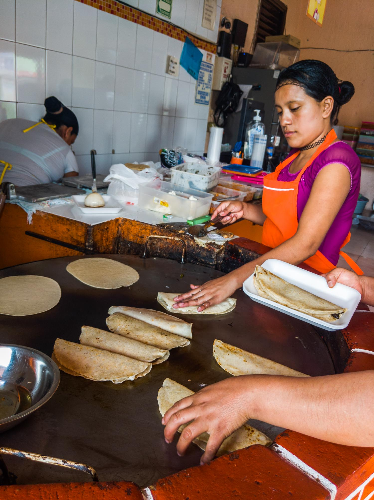Las Quekas restaurant in Playa del Carmen, women making quesadillas
