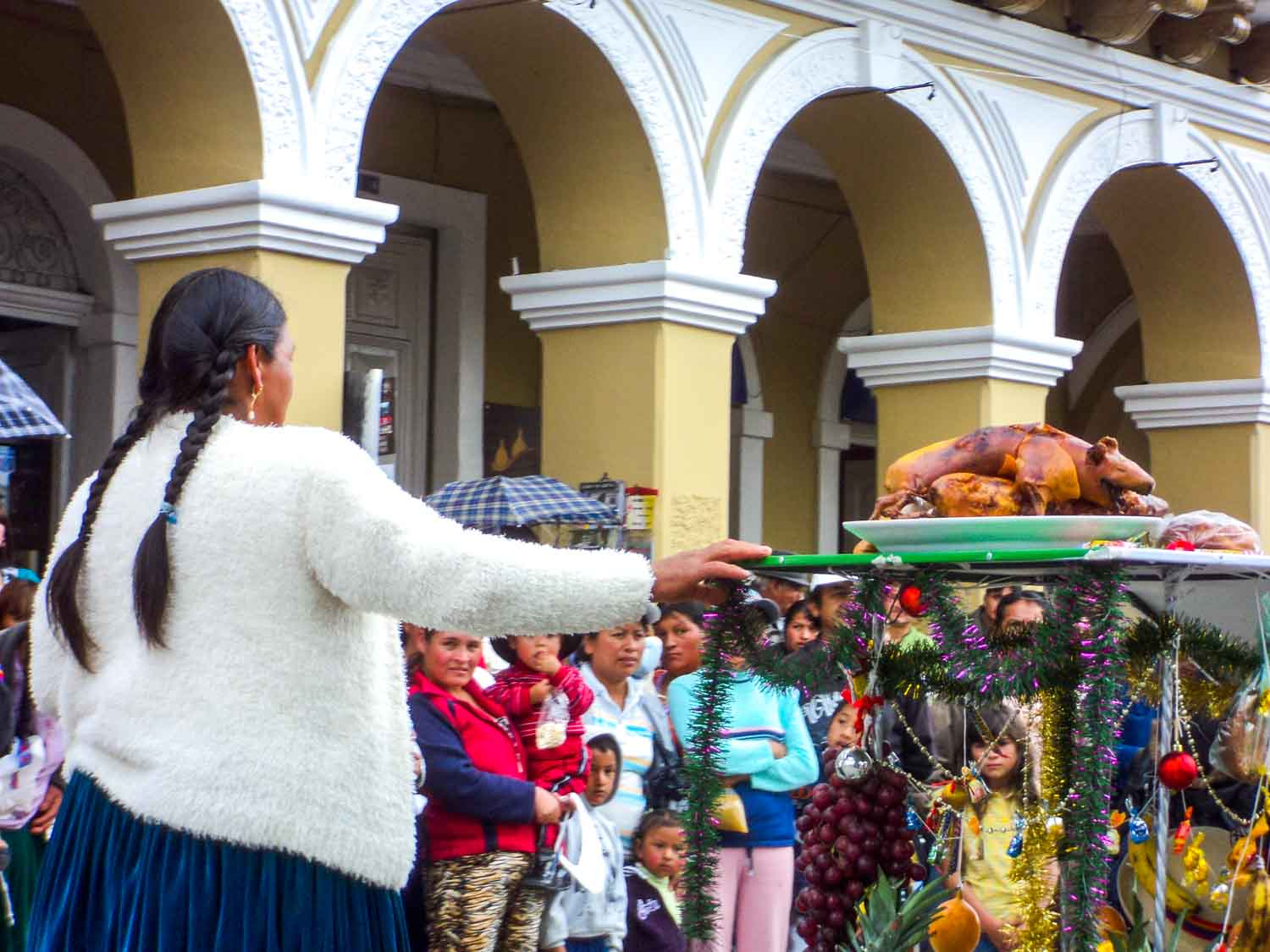 Offering of cuy at Pase del Niño Viajero parade in Cuenca Ecuador