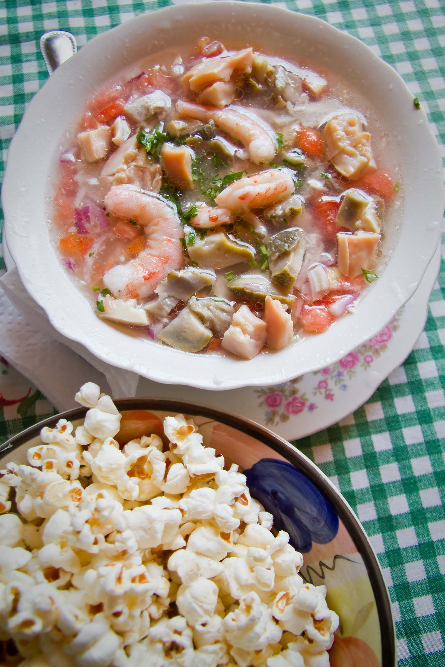 Ecuadorian ceviche with shrimp and served next to popcorn.