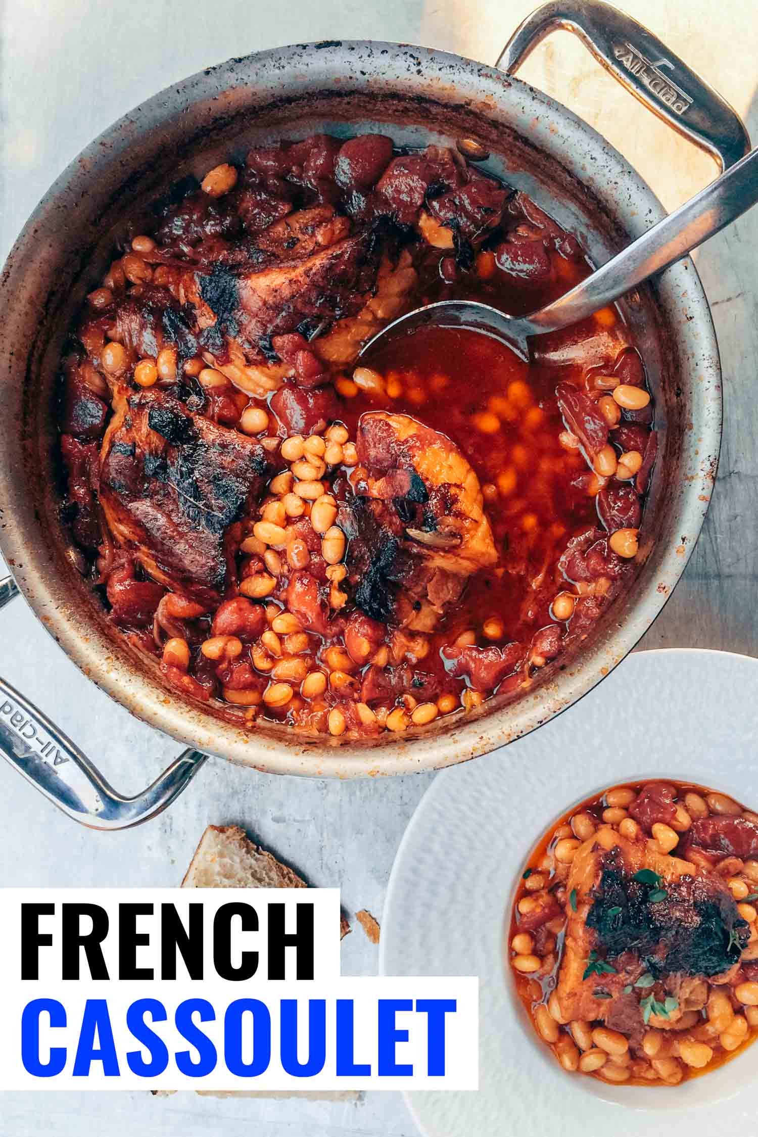 Classic French cassoulet with pork belly and navy beans in a pot on a table