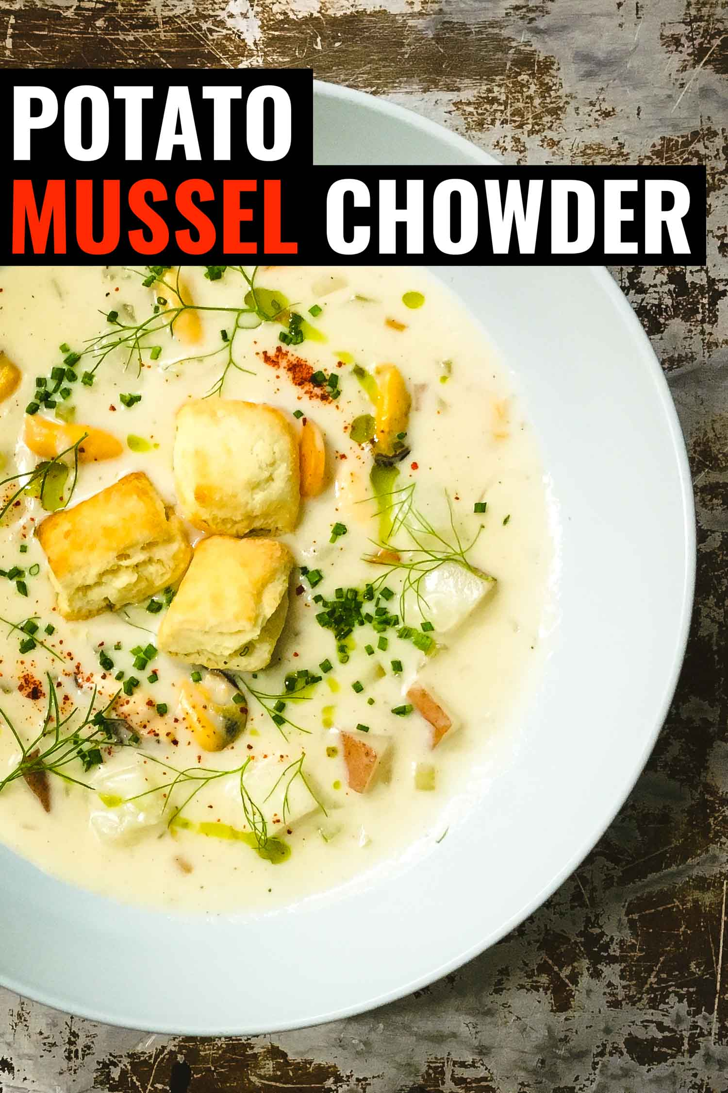 potato mussel chowder on a rustic background