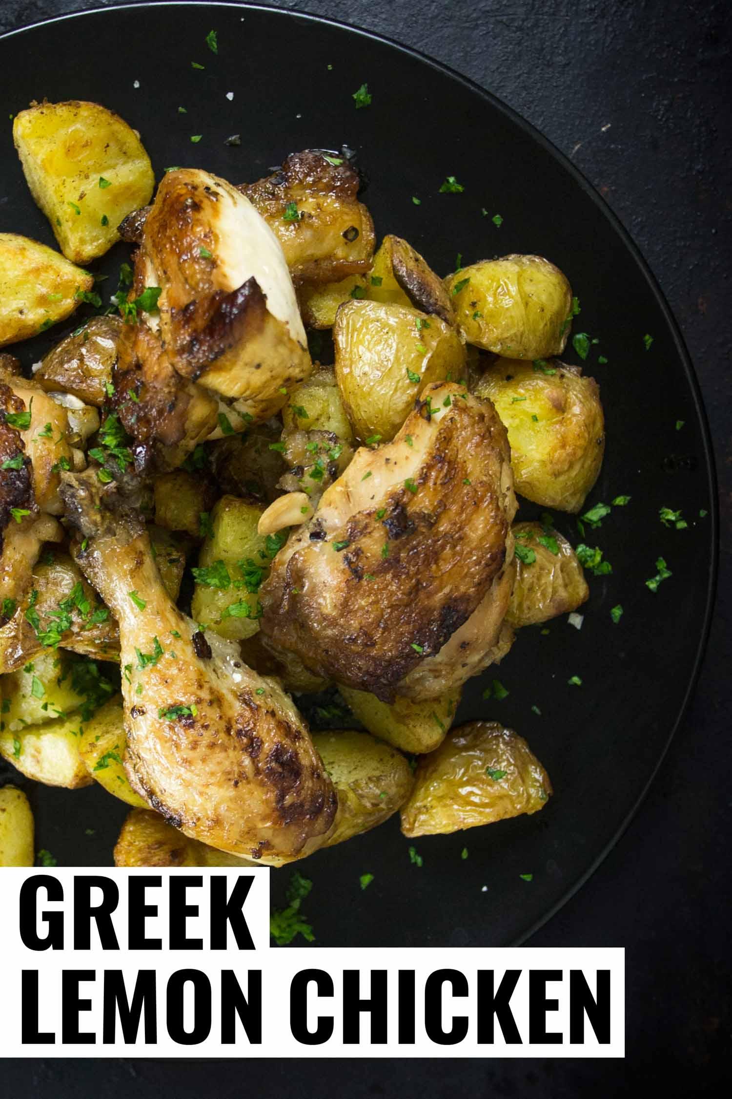 greek lemon chicken on a black plate