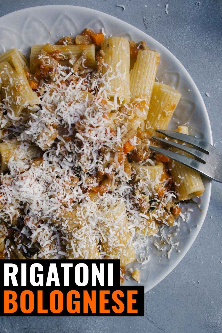 Rigatoni with a bolognese sauce on a blue background