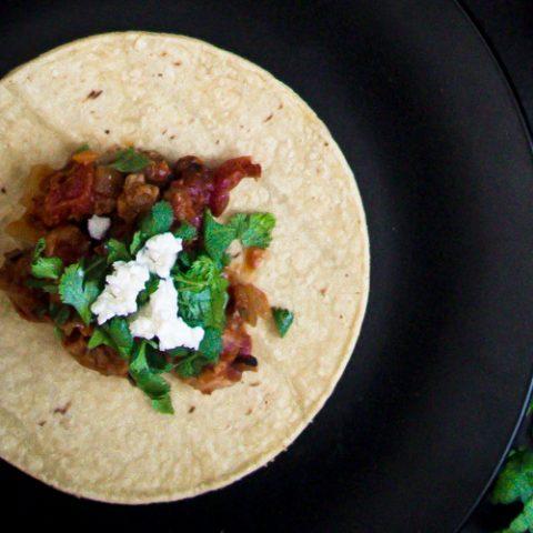 Mexican chicken tinga on a flour tortilla