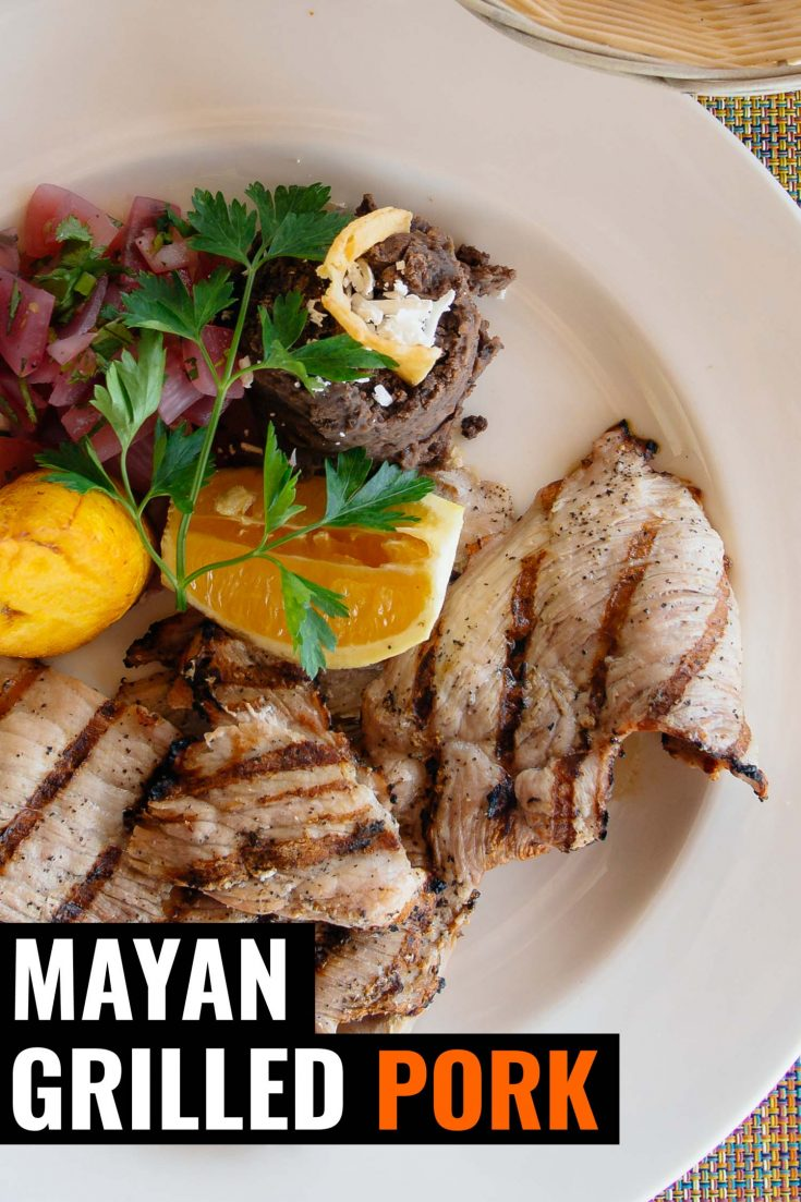 Poc chuc in Mexico is Mayan grilled pork that is marinated in sour orange juice and served with pickled onions. #pork #mexicanfoodrecipes #grilling #mexican #healthy #recipe