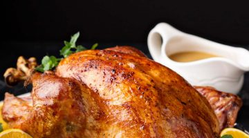 turkey cooked in instant pot on table with side dishes for thanksgiving