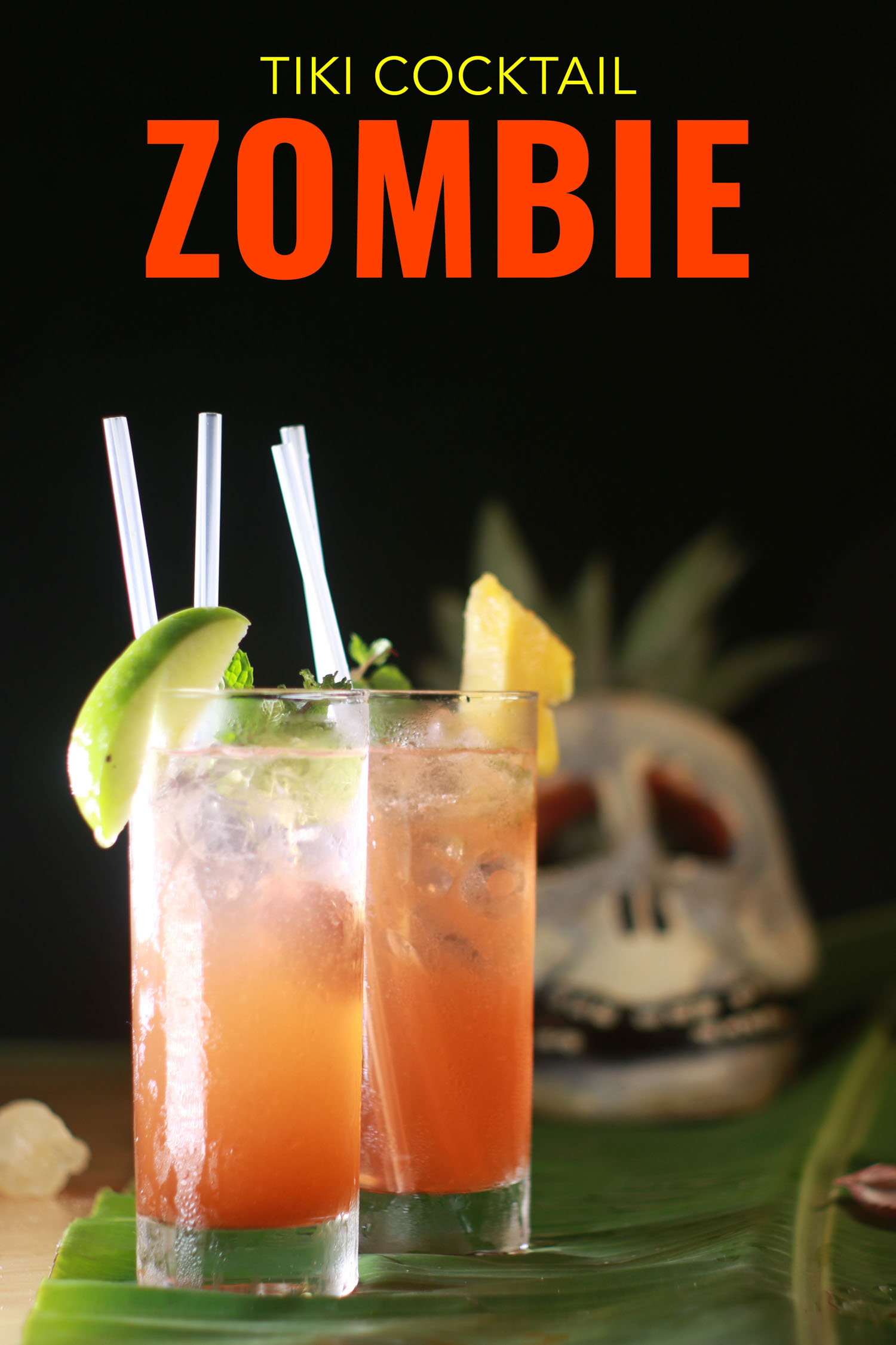 Tiki cocktail called the zombie with a skull behind it
