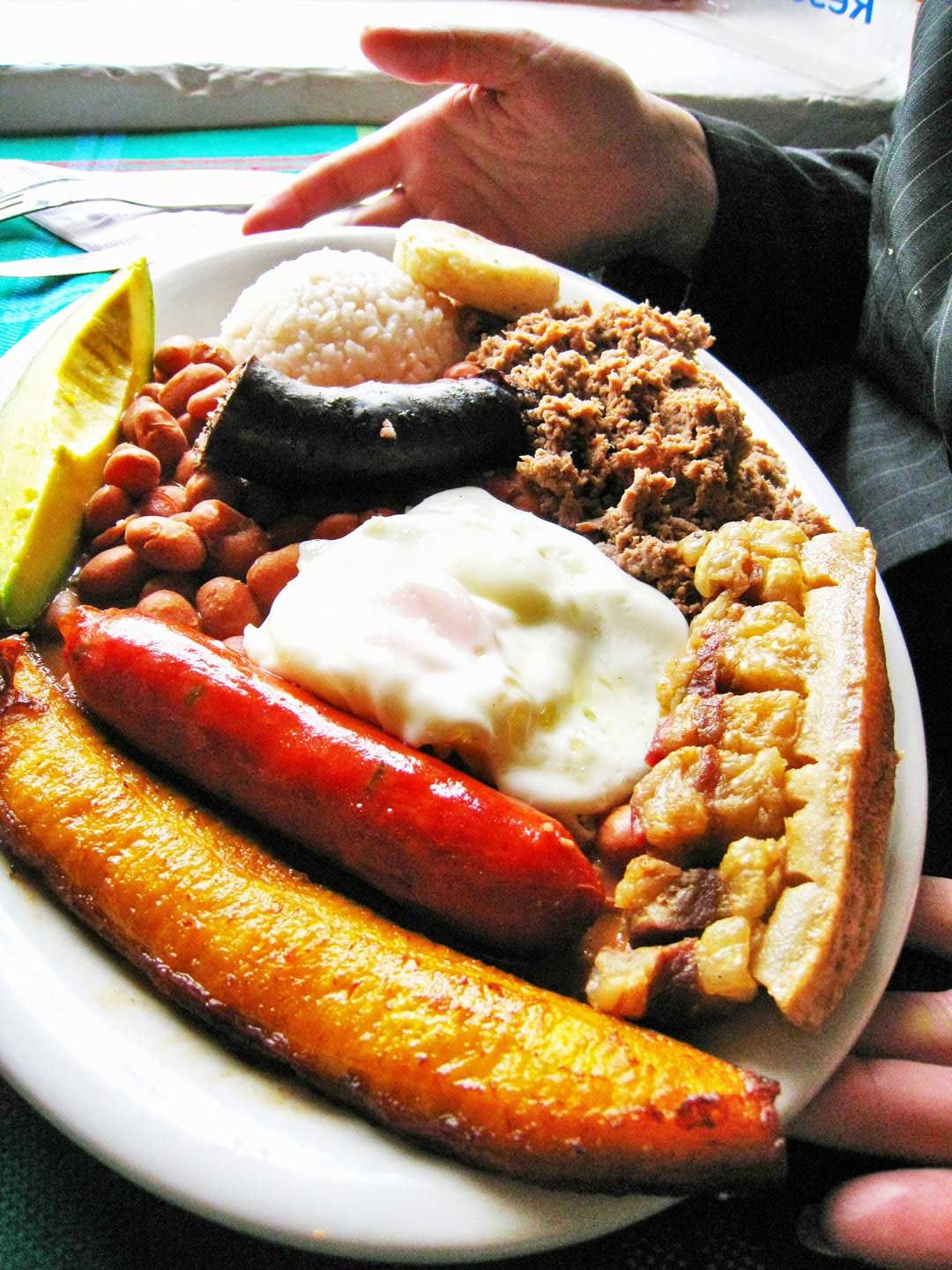Bandeja Paisa is a Colombian food you should eat, so popular it is considered Colombia's national dish.