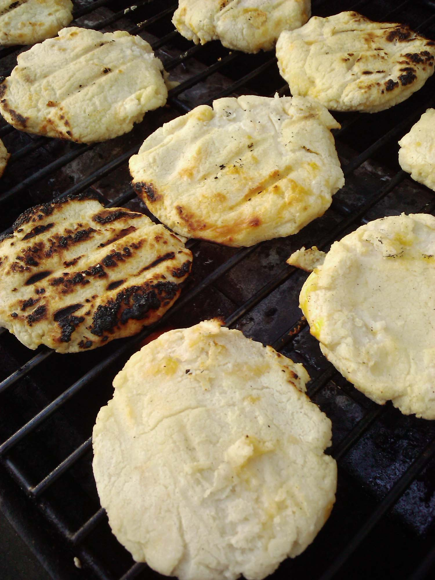 Arepas are a traditional Colombian street food that you must try.