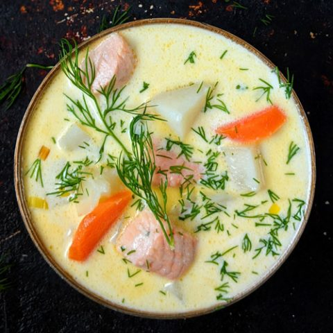 Lohikeitto Finnish salmon soup in a bowl on a dark background