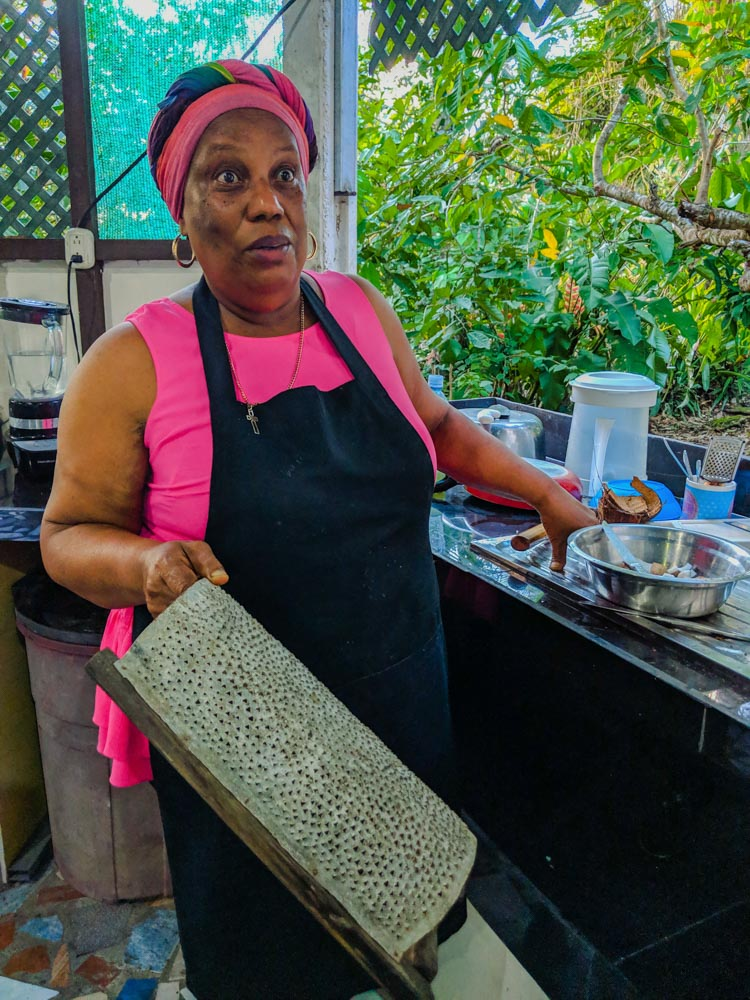 Using a coconut grater to make Caribbean rice and beans.