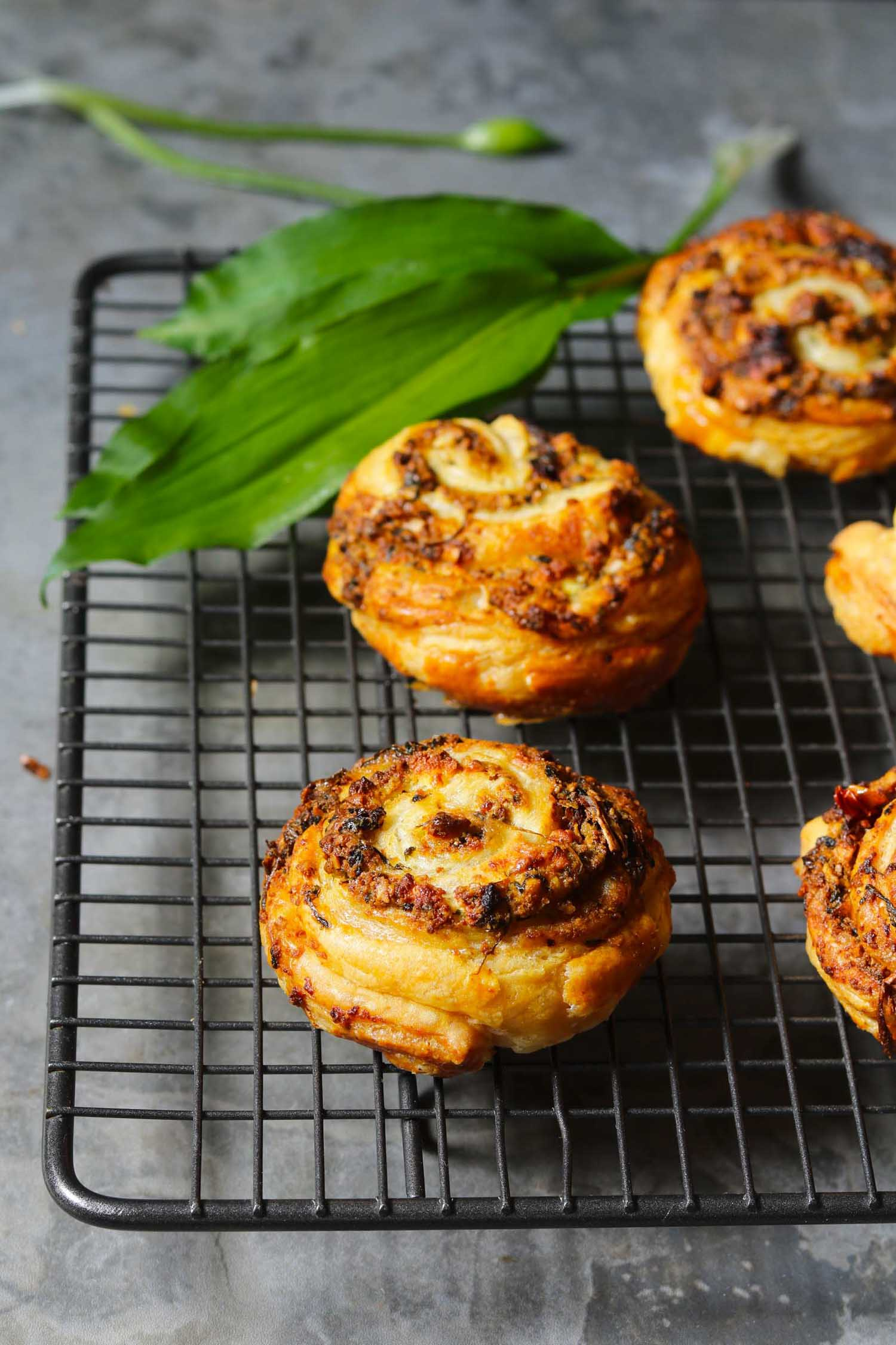 Sundried Tomato Swirls with Wild Garlic Pesto on a baking sheet