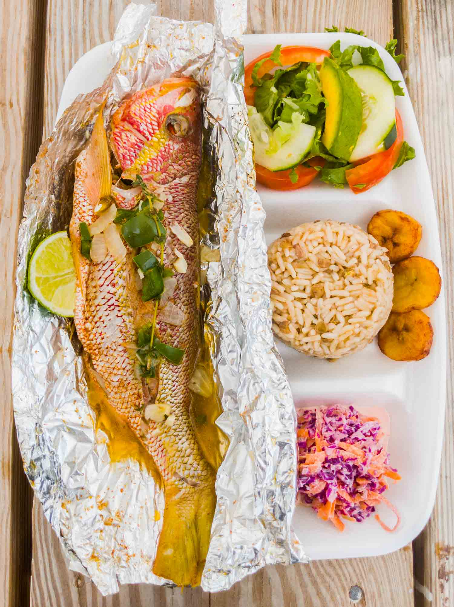 Foil roasted snapper and sides from Sunshine Shack in Anguilla.