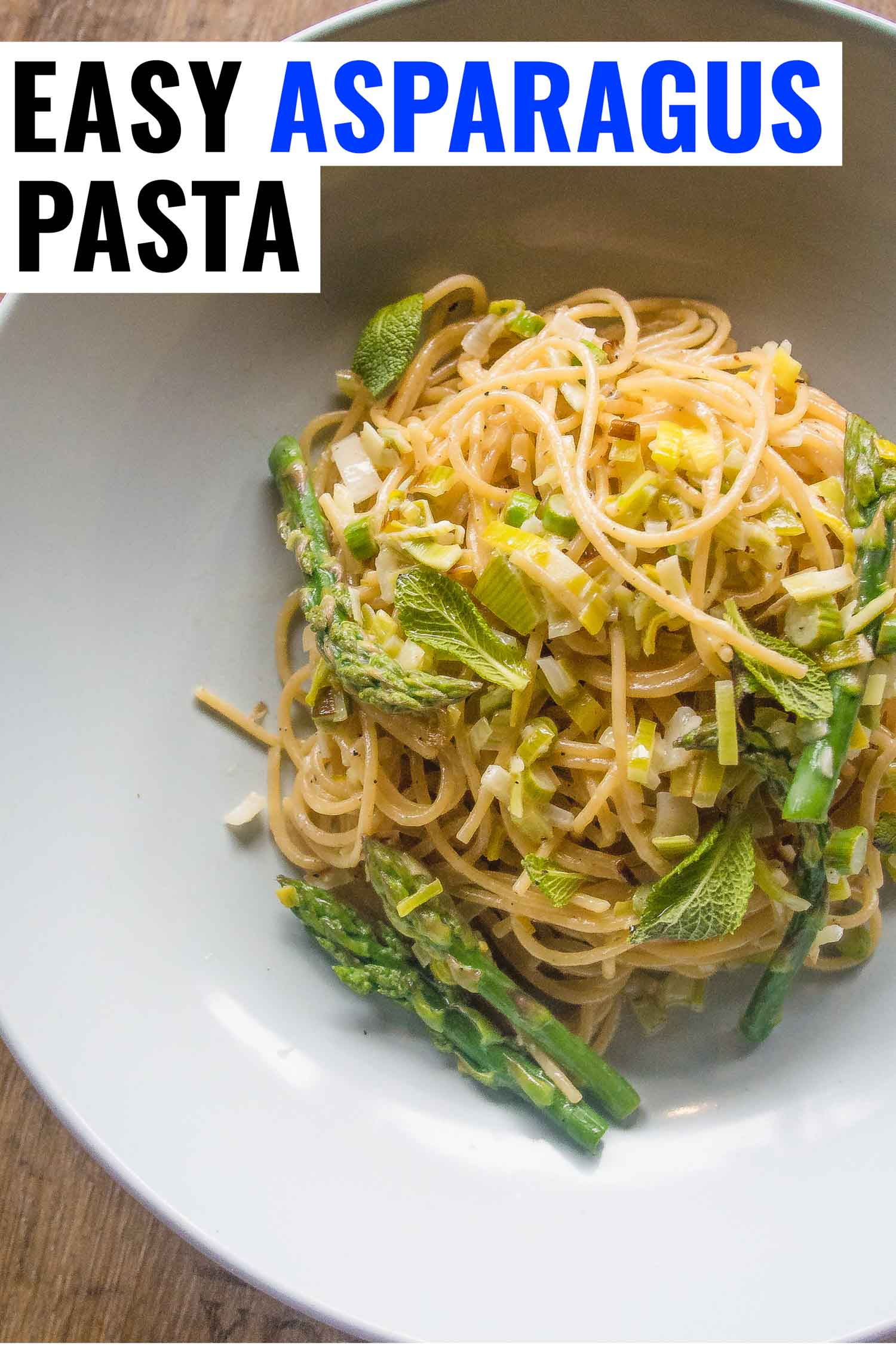 asparagus pasta in a bowl with lemon cream and leek