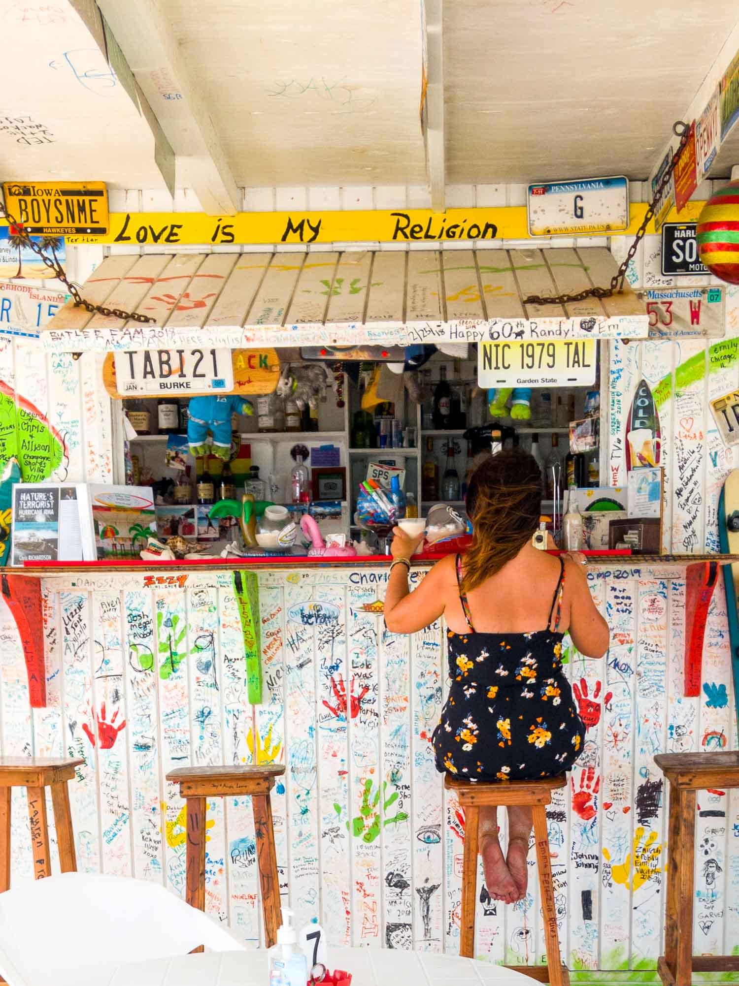 Ayngelina sitting at beach bar on Anguilla island