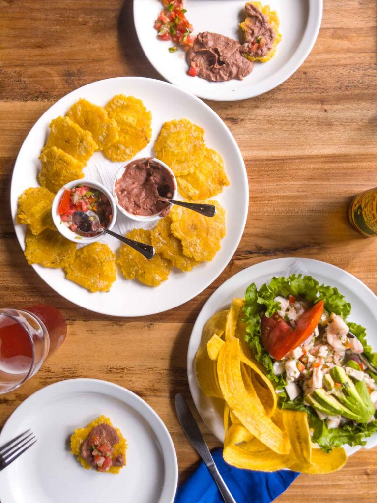 Costa Rican lunch with ceviche and patacones.