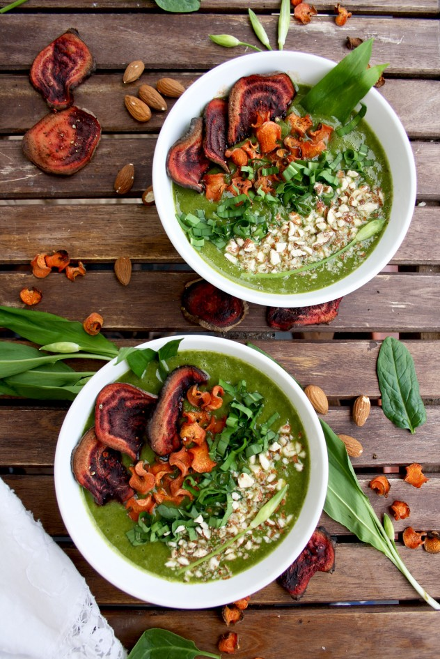 Two bowls of a wild garlic soup a popular ramps recipe, on a wooden backgrouns