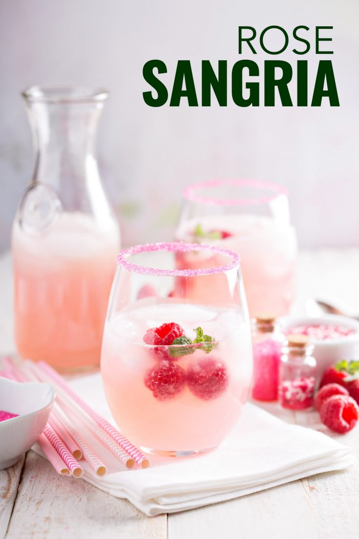 This rose sangria recipe is a twist on the classic Spanish sangria but uses rose wine, peaches and raspberries. #rose #sangria #drink #punch #cocktail #raspberry #punch #wine #easy #recipes #simple