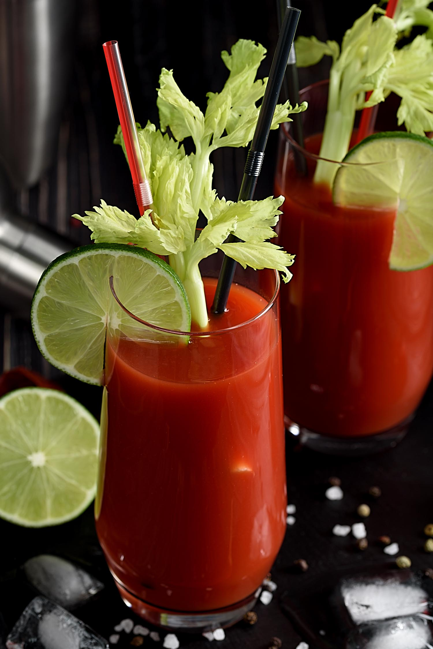 Canadian Caesar drink and ingredients: pepper chili, lime, celery, ice and shaker.