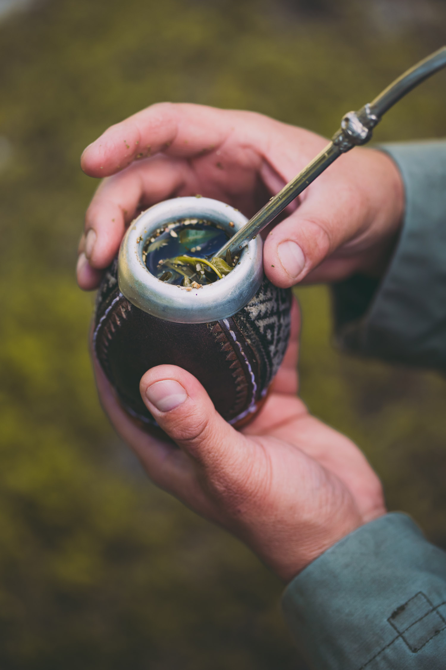 Man Holding Yerba Mate In Nature.