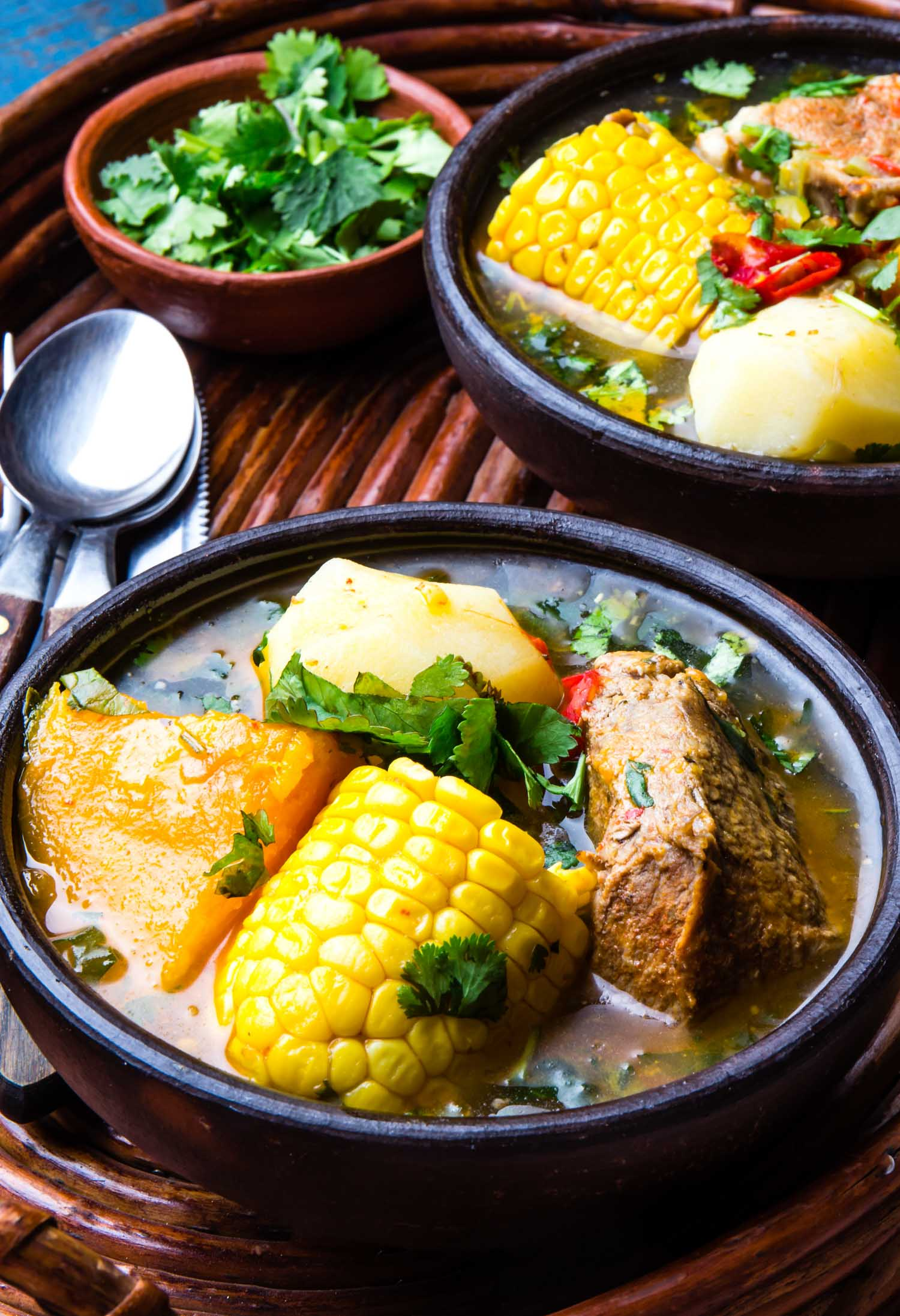 Latin American chilean food. Traditional chilean cazuela de cerdo with chuchoca. Pork soup with potatoes pumpkin. corn served in clay bowl from Pomaire.
