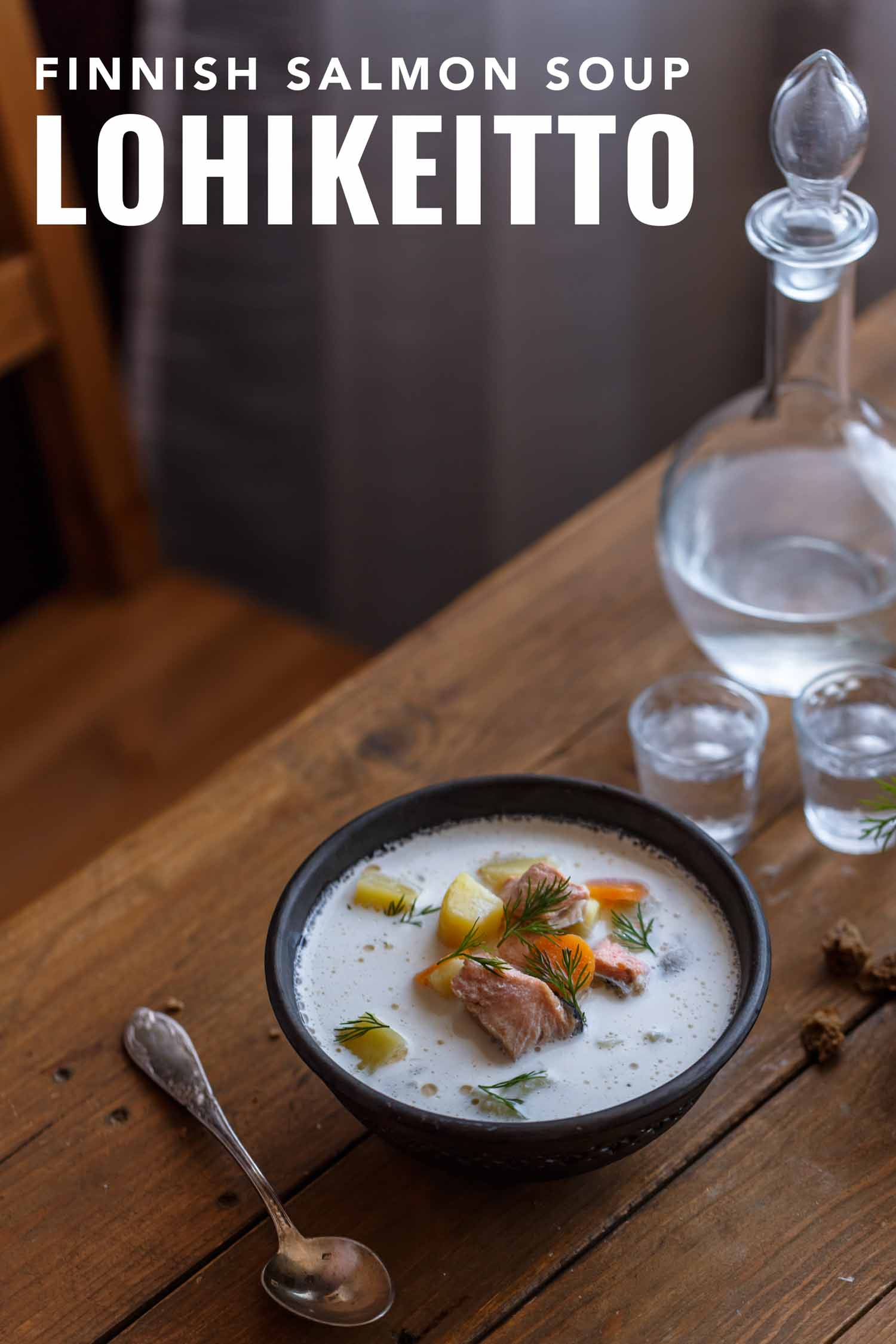 Lohikeitto, Finnish salmon soup, on wooden table.