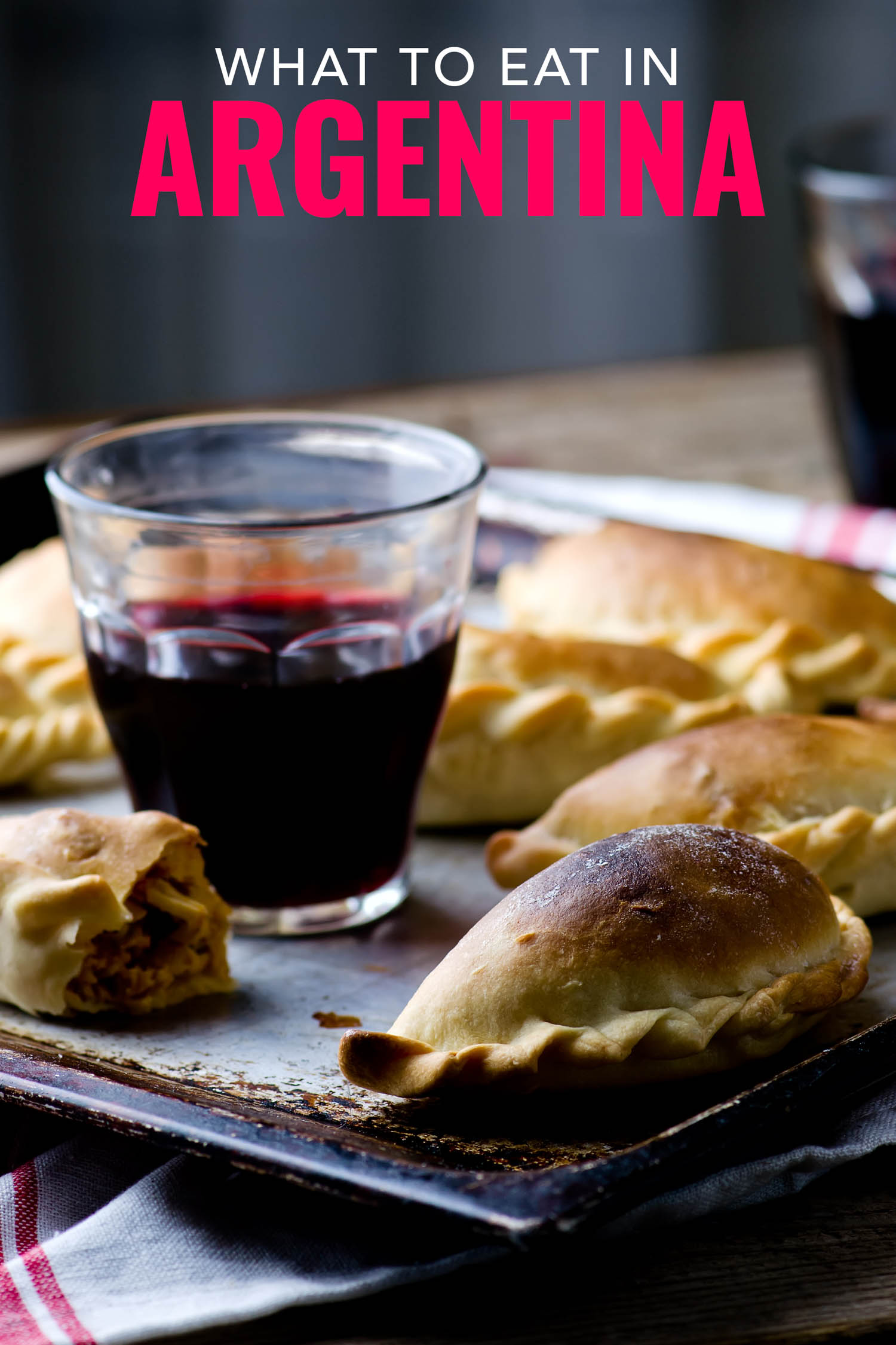Argentinian food includes red wine and empanadas.