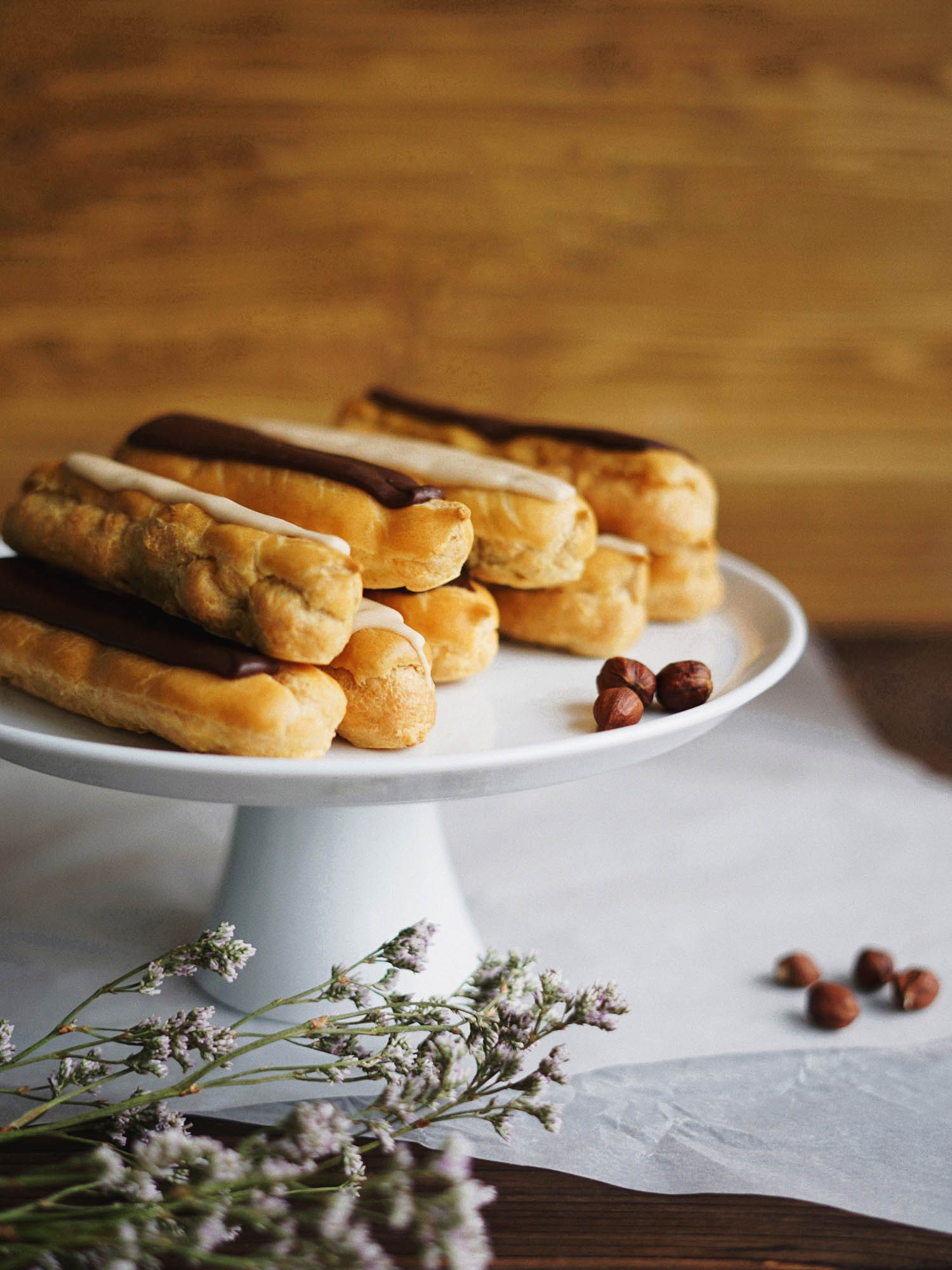 Classic French eclairs on a pastry stand.