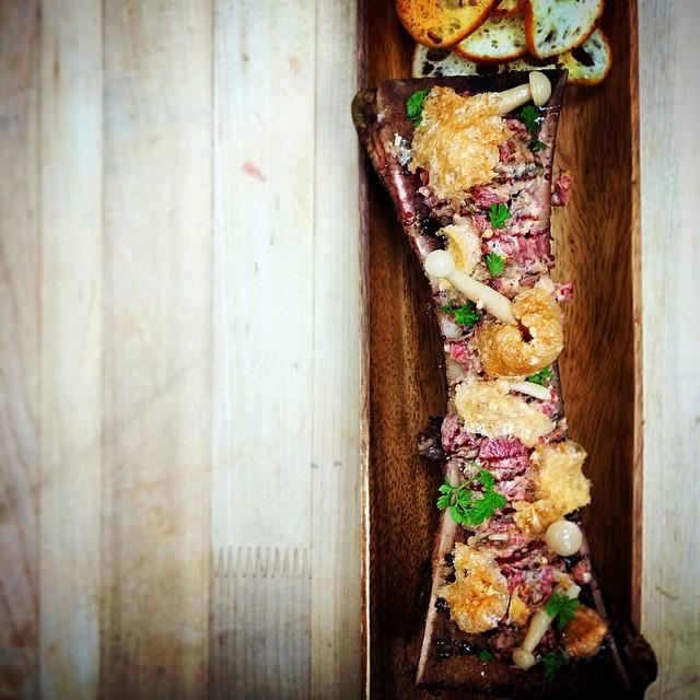 Bone marrow, a common food in Paris, on a cutting board