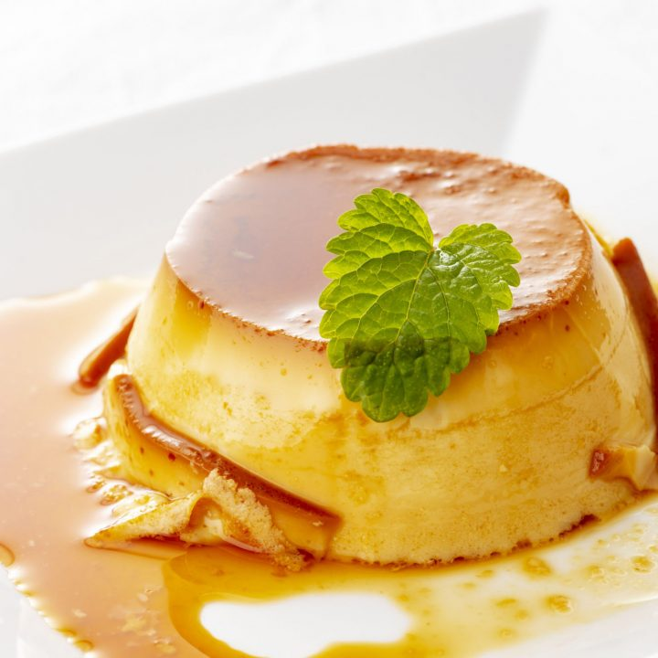 Cuban flan with mint on white plate