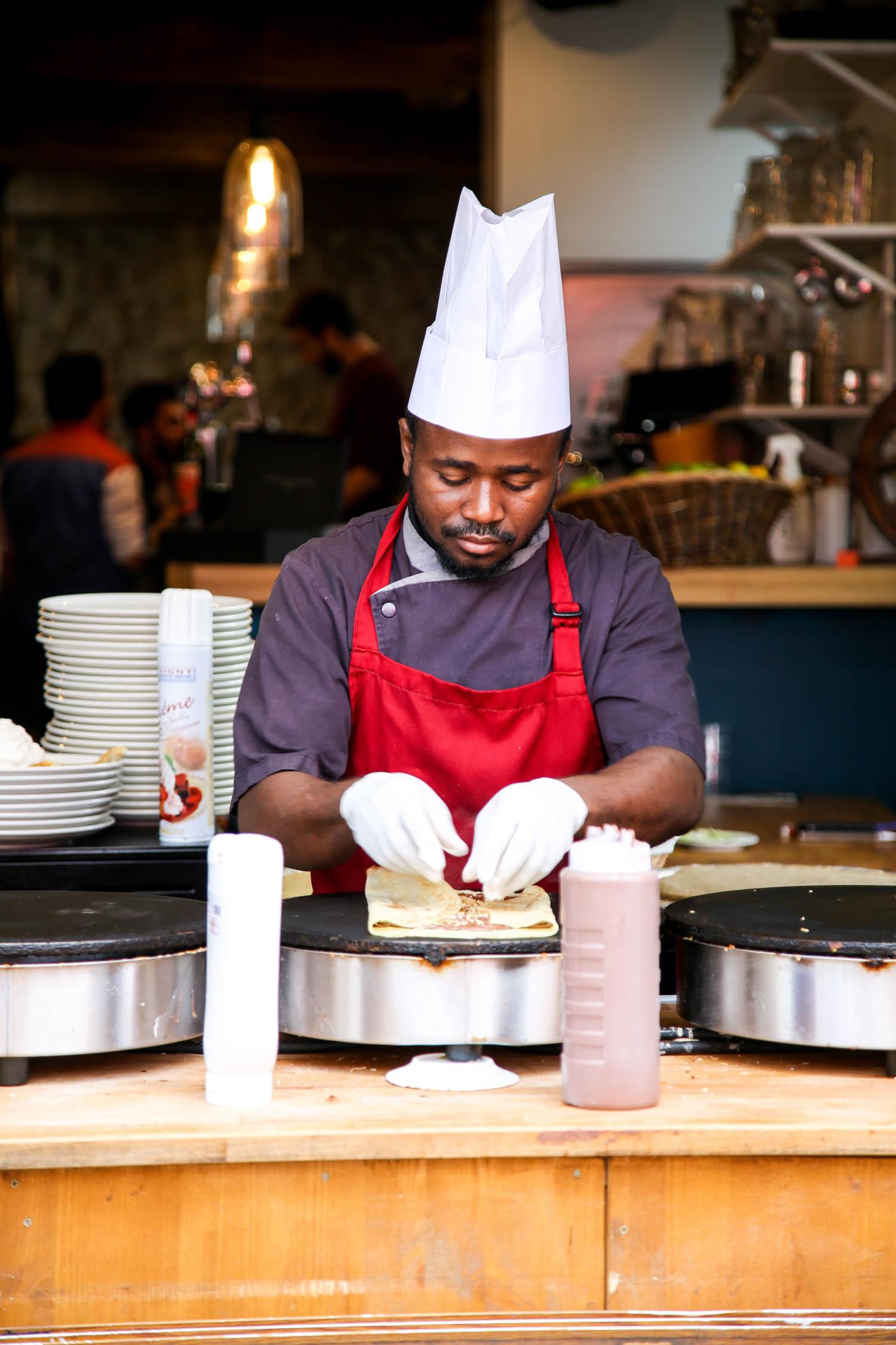 Man making crepes at a restaurant in Paris