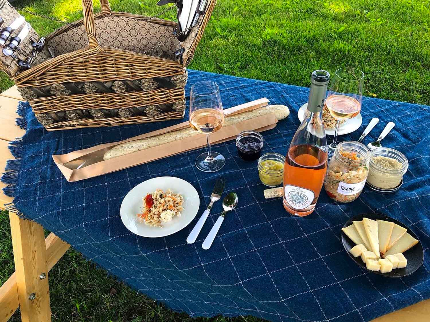 Picnic table with Mercator Vineyards wine and cheese