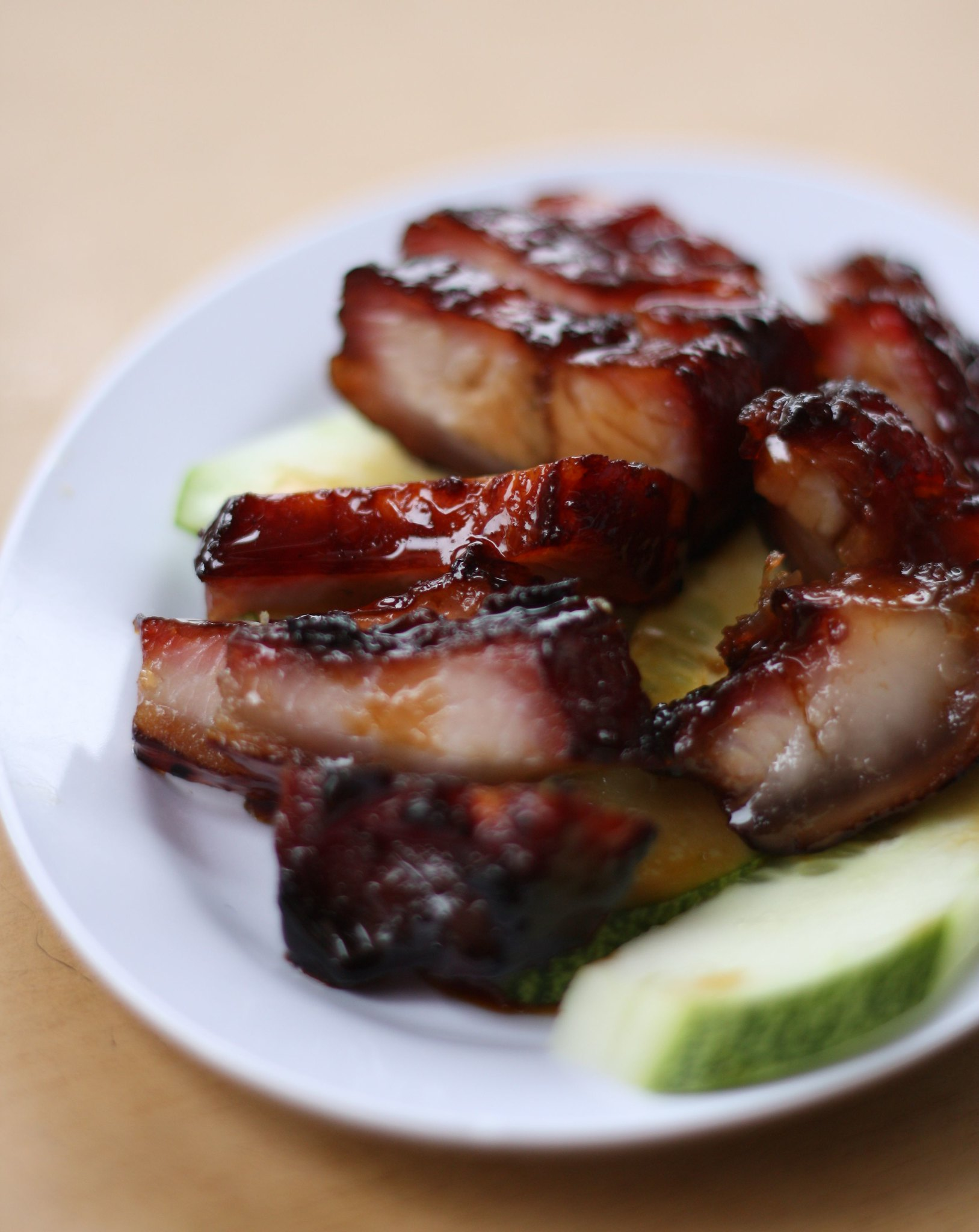Char siu, traditional Hong Kong cuisine, pork on a white plate.