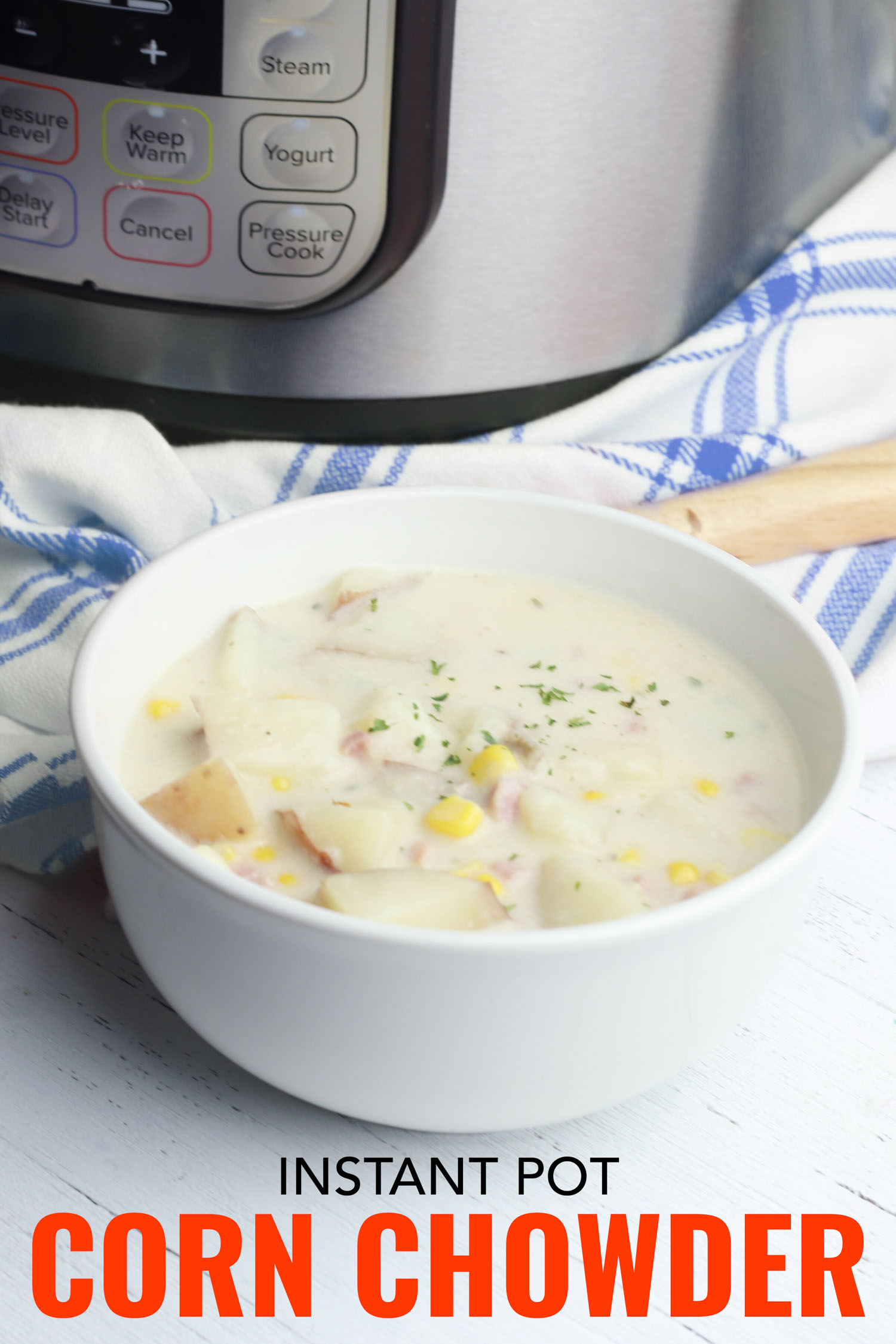 Corn and ham chowder in a bowl beside an instant pot