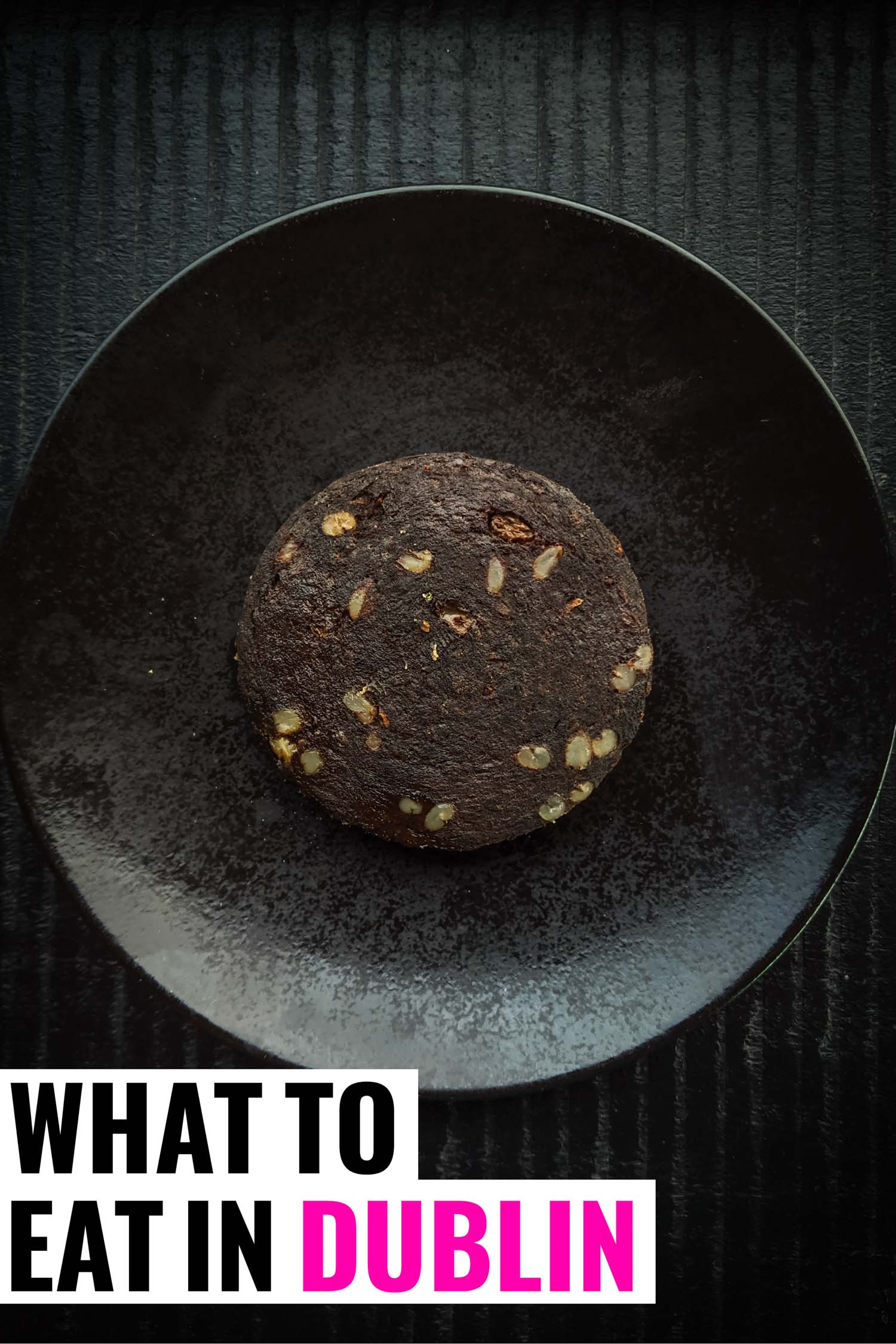 Typical Dublin food, black pudding on a black plate and background.