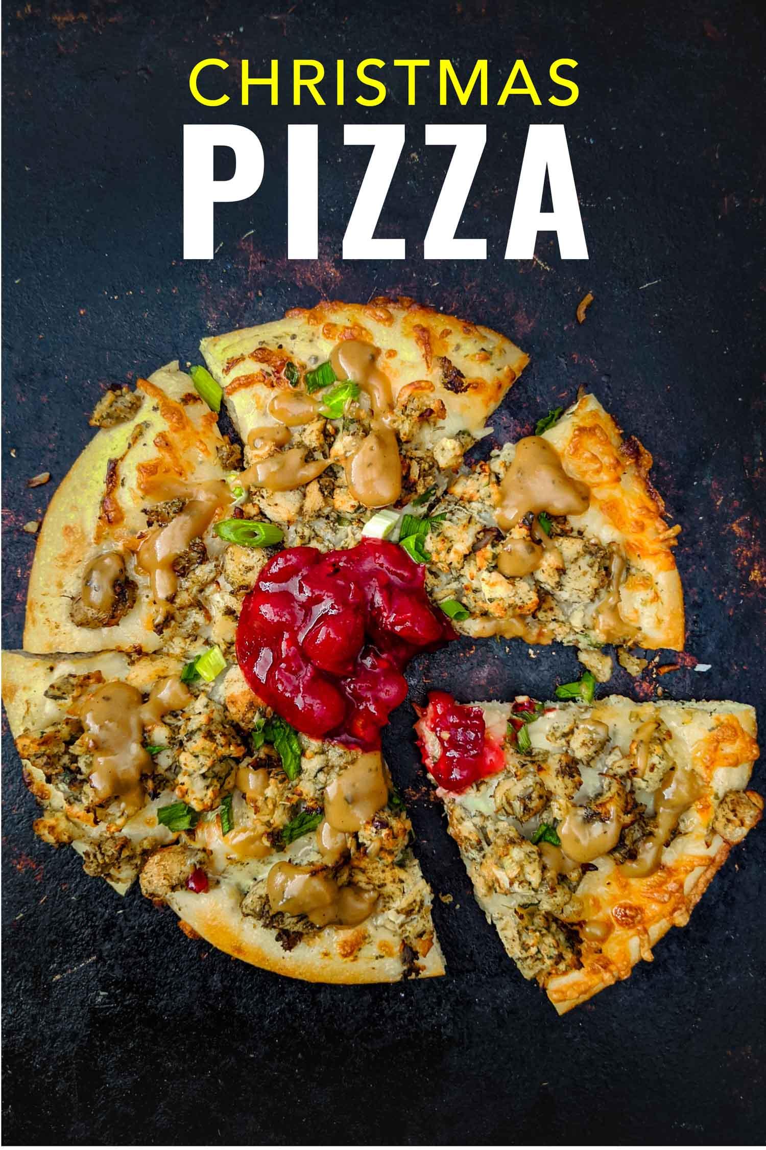 Christmas pizza or thanksgiving pizza using turkey dinner leftovers on black.