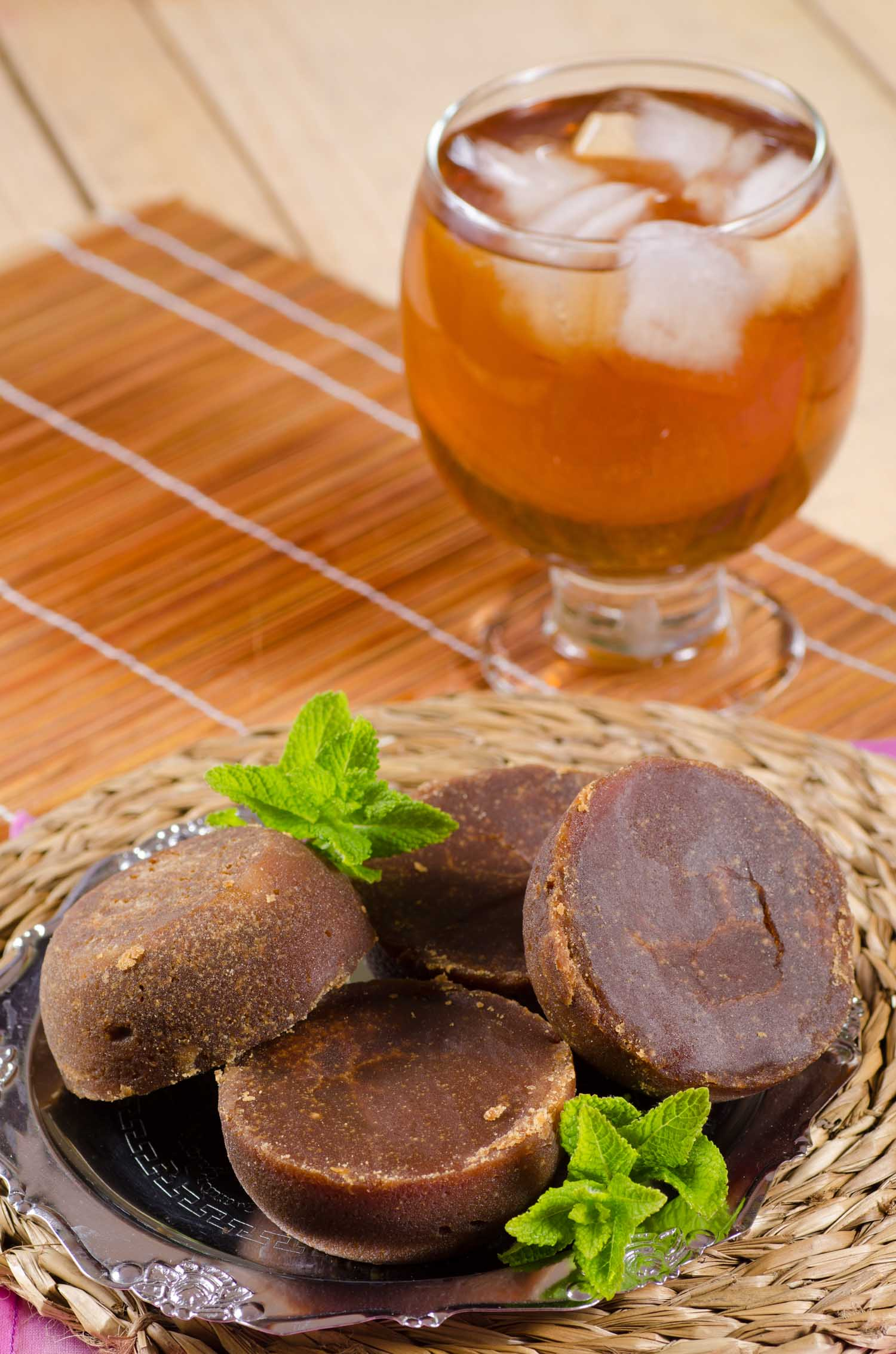 Aguapanela, traditional Latin American drink prepared with raw brown sugar panela.