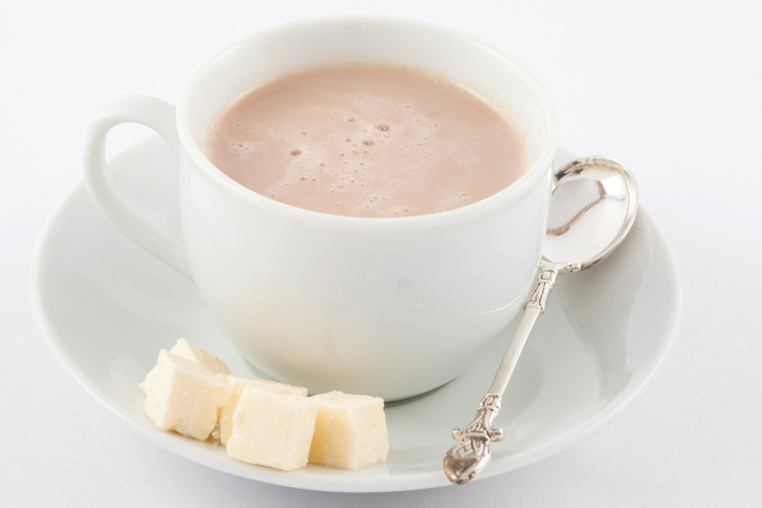 Cup of hot chocolate with cheese served in white dishware
