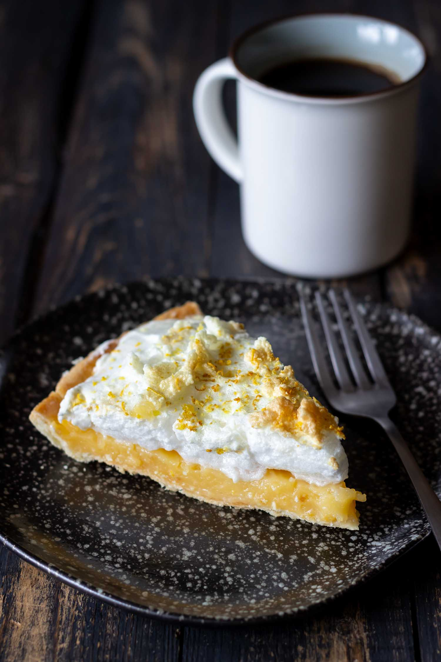 In Peru with lemon meringue on a wooden background. Tart. Bakery products. Dessert. Homemade food.