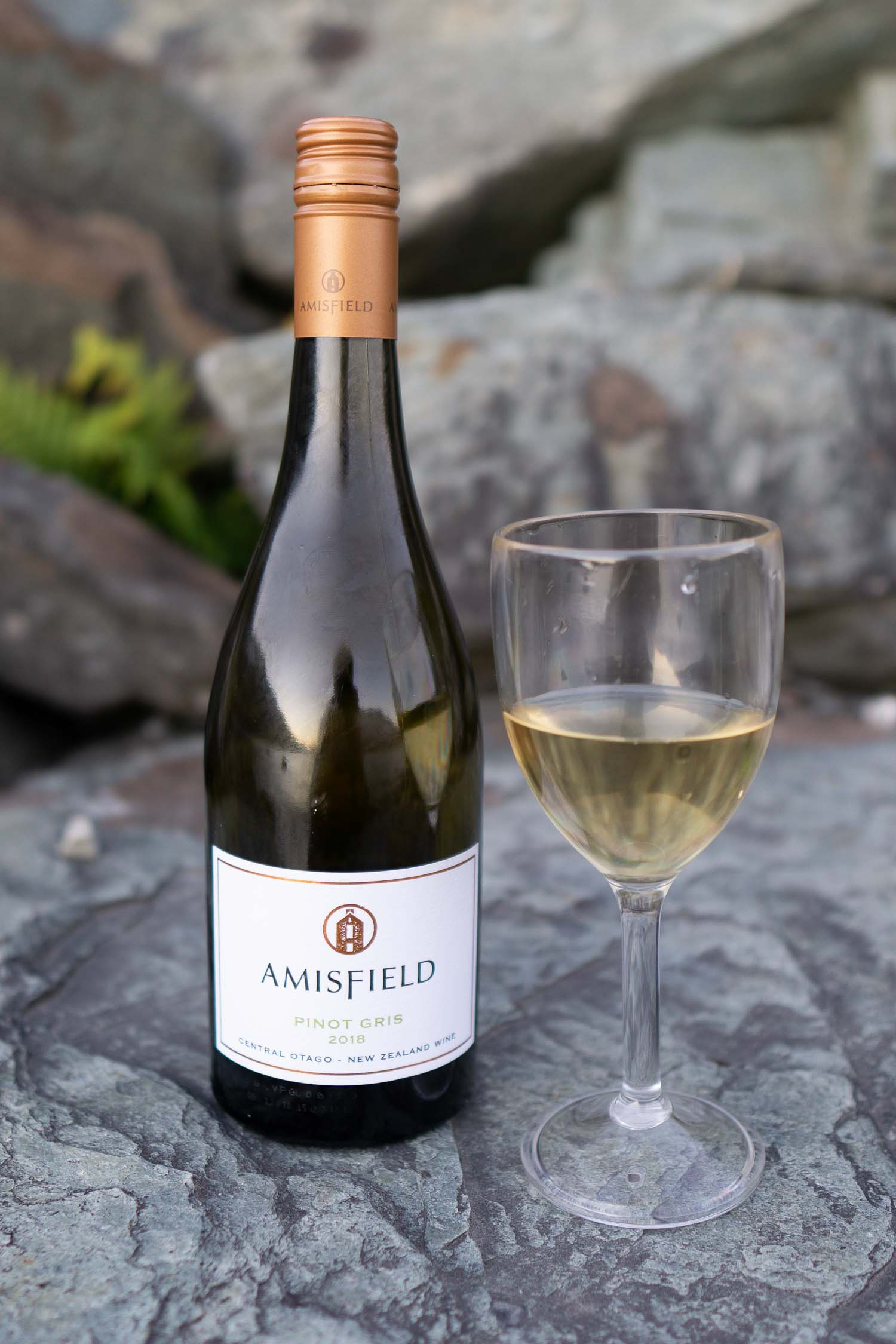 Bottle of Matawhero Wines and glass of wine, one of the most popular vineyards in New Zealand.